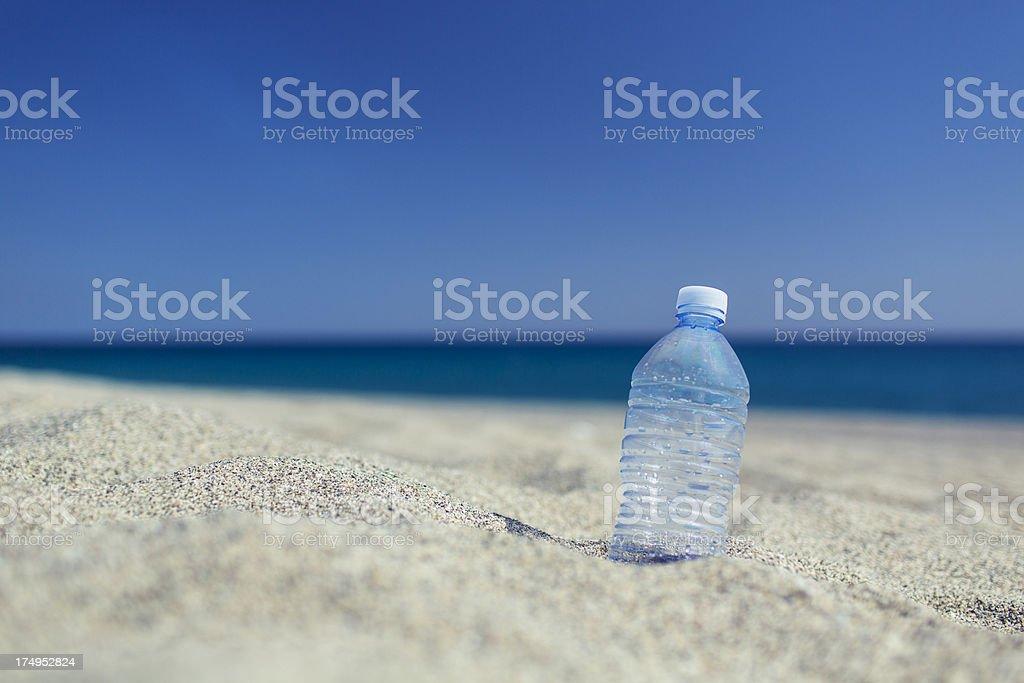 Empty plastic bottle on the sand beach stock photo