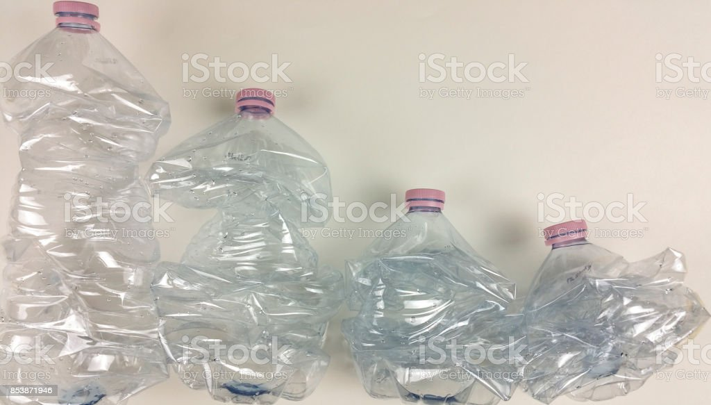 Empty plastic bottle on white background - top view stock photo