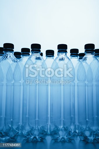 empty plastic bottle silhouettes on blue background with copy-space