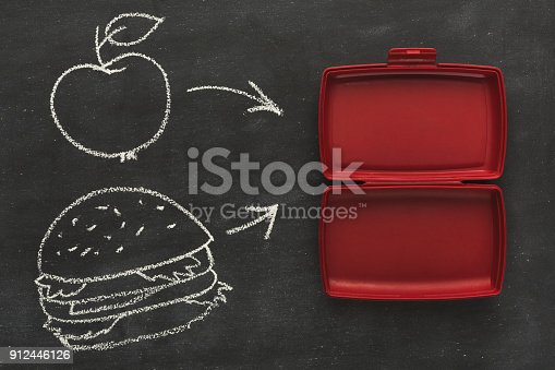 istock Empty plastic food container on black background 912446126