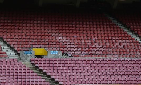 Empty plastic stadium seats.