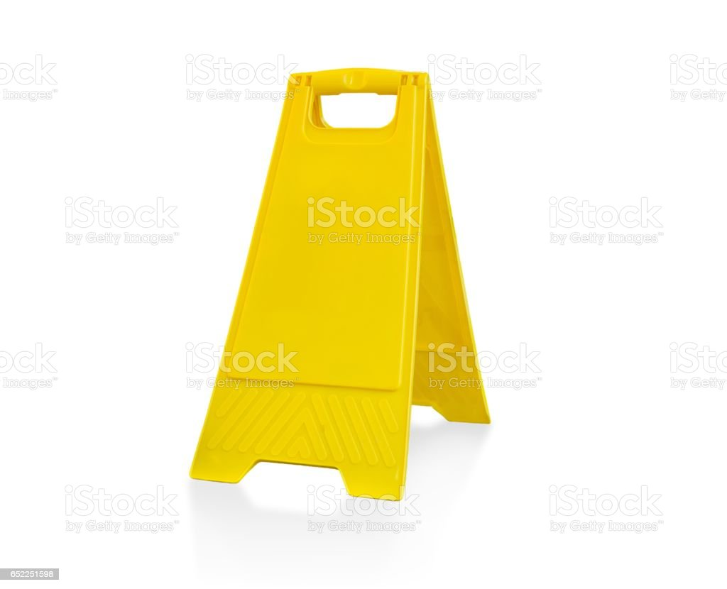 Empty plastic yellow warning board. Isolated on white background. stock photo