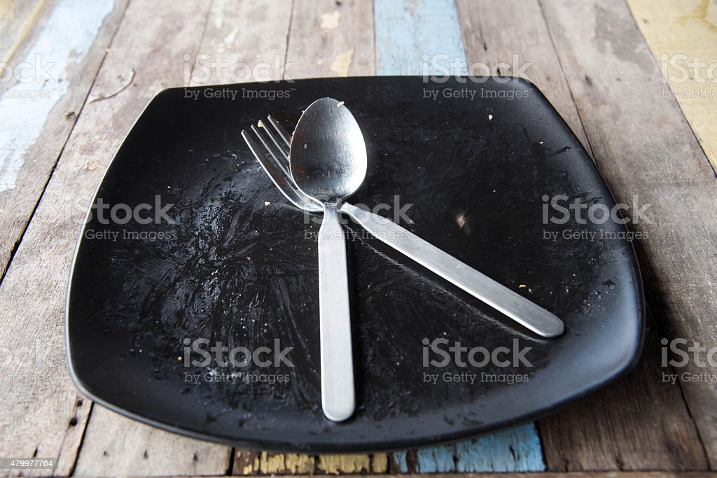 Empty plate after food on wood stock photo