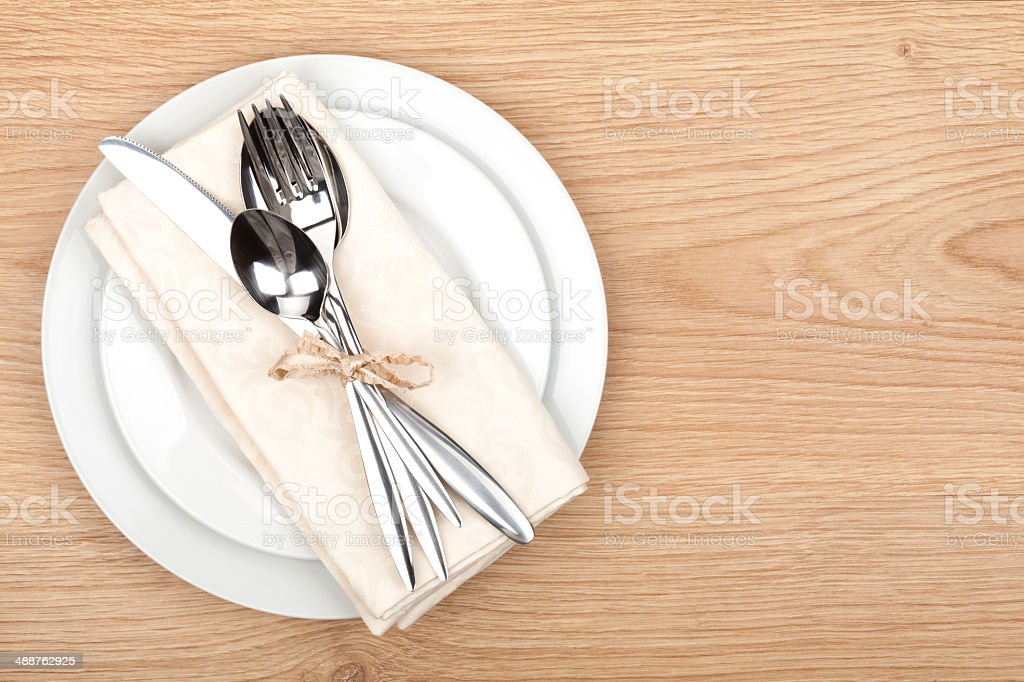 Empty plate and silverware set stock photo