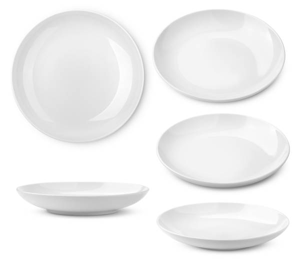 Empty plate, isolated on white background, clipping path, full depth of field Empty plate, isolated on white background, clipping path, full depth of field plate stock pictures, royalty-free photos & images