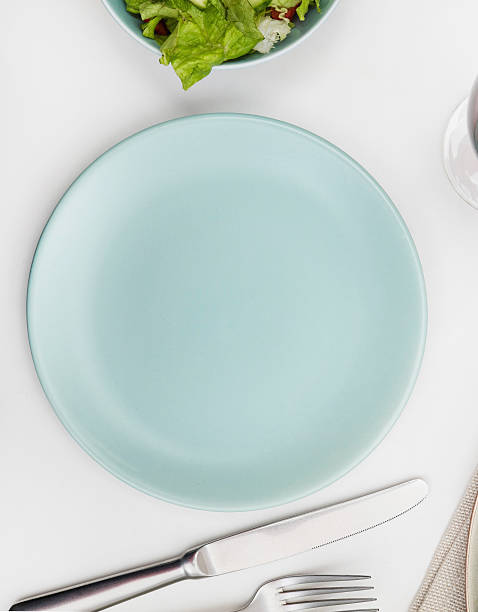 Empty plate on a dining table stock photo