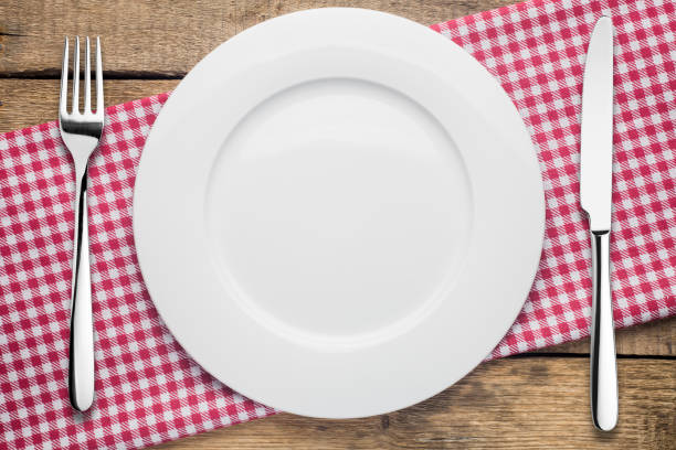 empty plate on a wooden background, a napkin in a red and white - plate stock pictures, royalty-free photos & images
