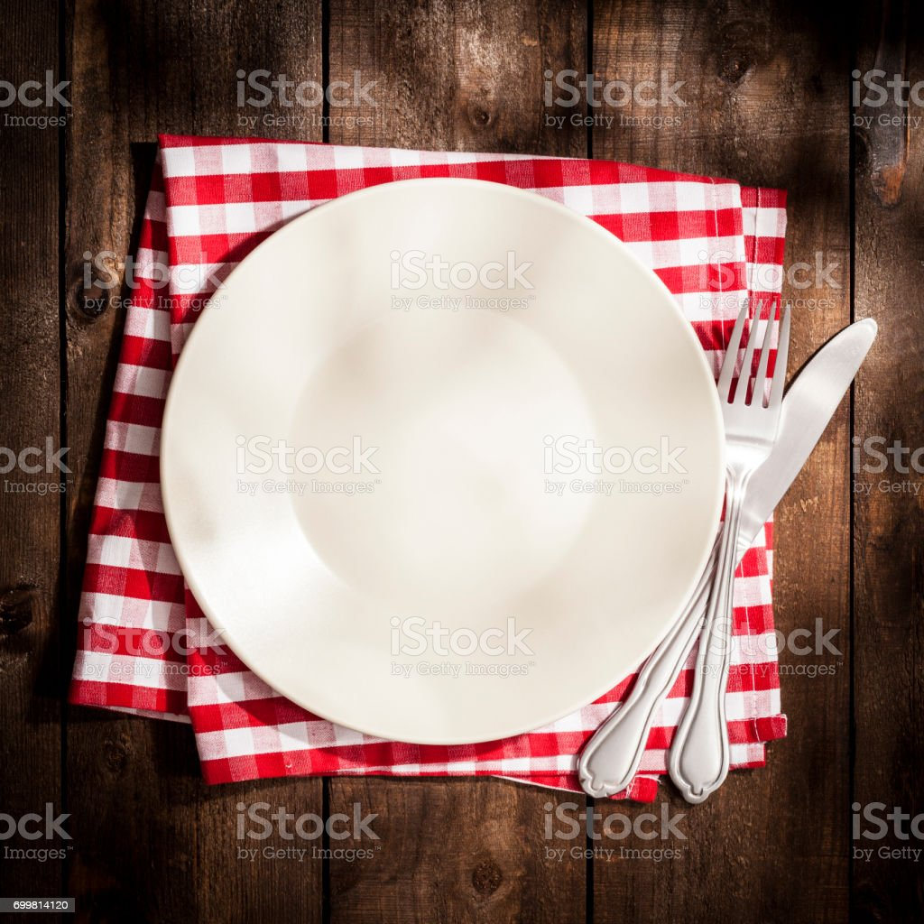 Empty plate on rustic wooden table stock photo