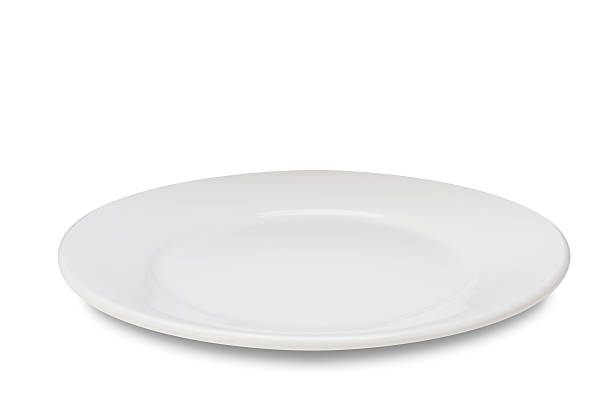 empty plate on white - plate stock pictures, royalty-free photos & images