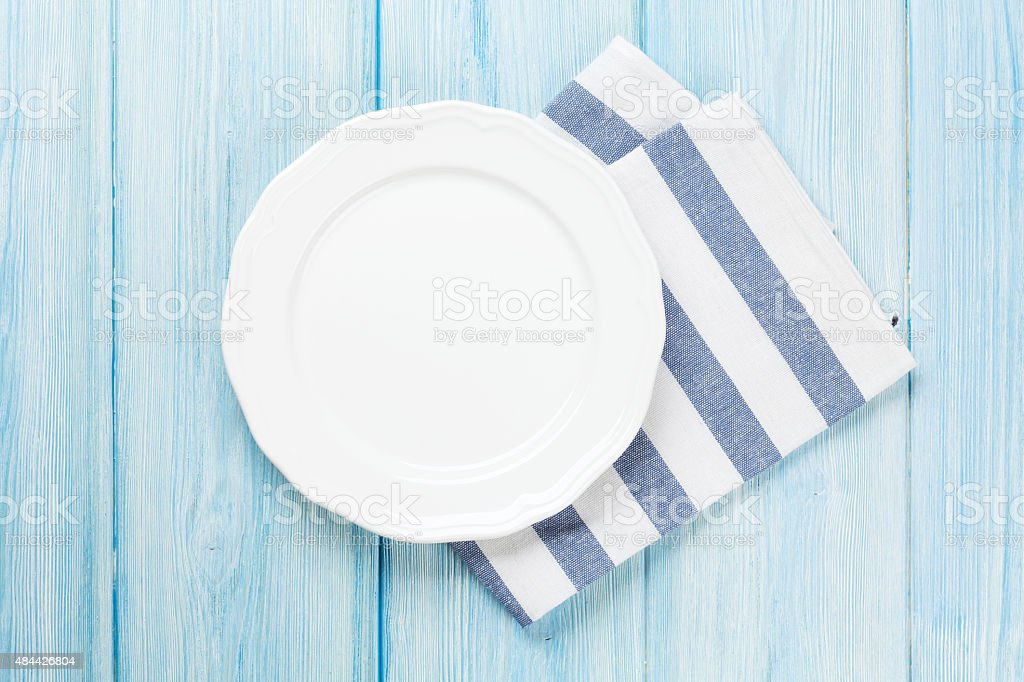 Empty plate over wooden table background stock photo