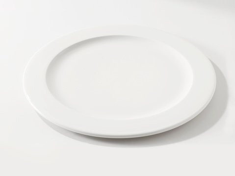 Looking down empty plate on white table