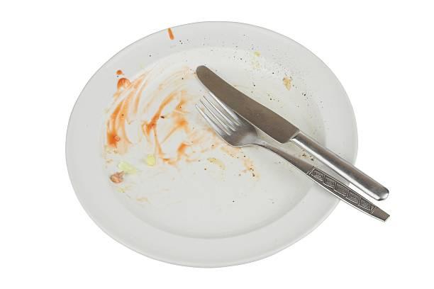 """prato vazio manchado com alimentos """"permanece - desperdício alimentar imagens e fotografias de stock"""
