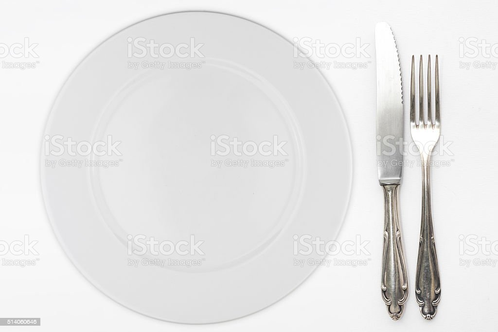 empty plate with beautiful silver knife and fork stock photo