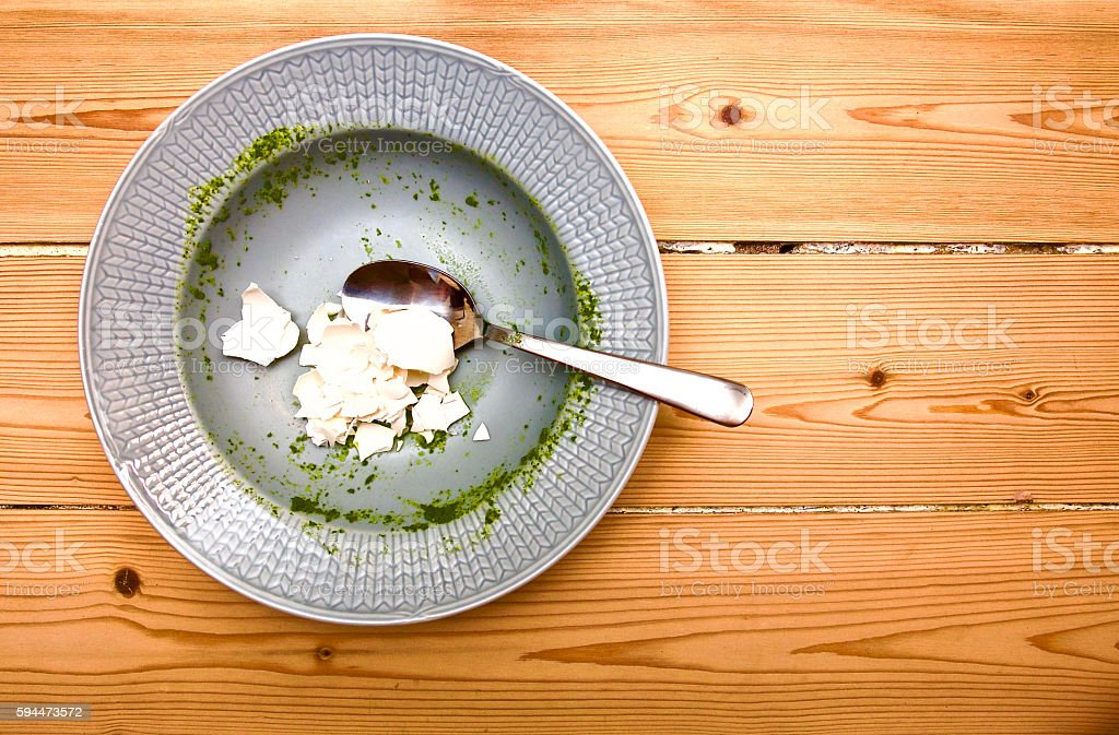 Empty plate with eggshells stock photo