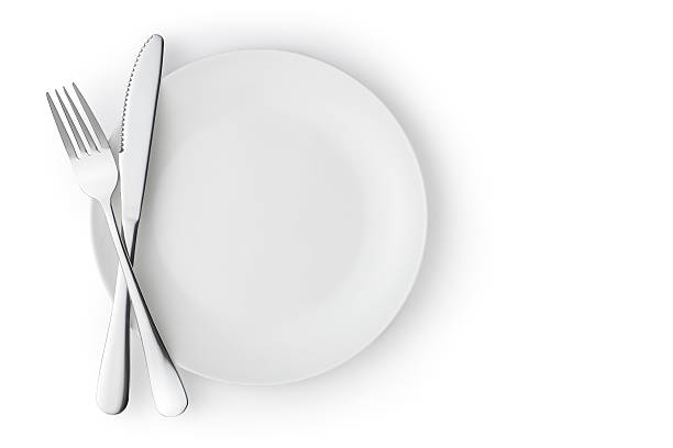 empty plate with fork and knife - table knife stock photos and pictures