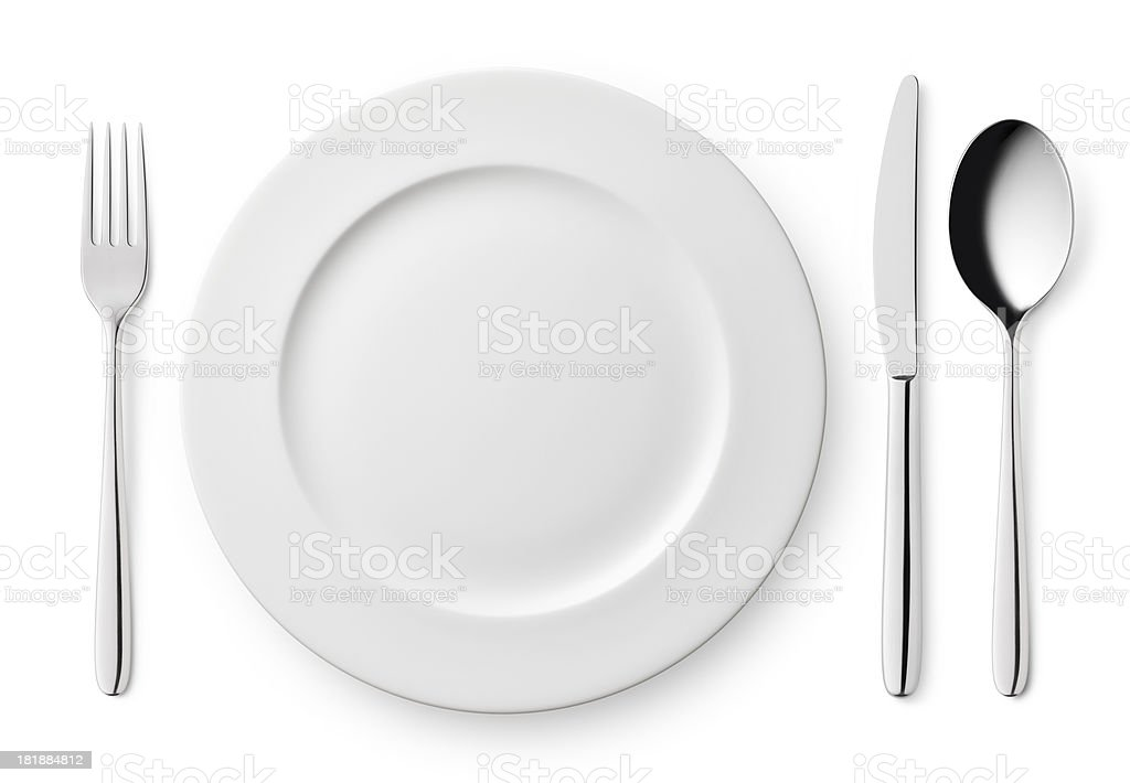 Empty plate with fork, knife and spoon stock photo