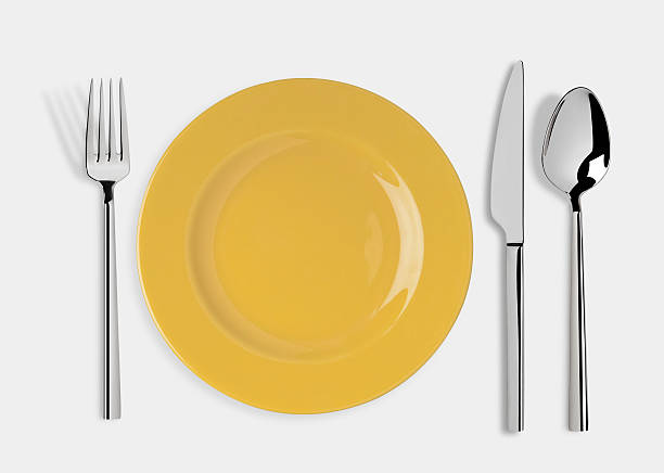 Empty plate with Knife, Spoon and Fork stock photo