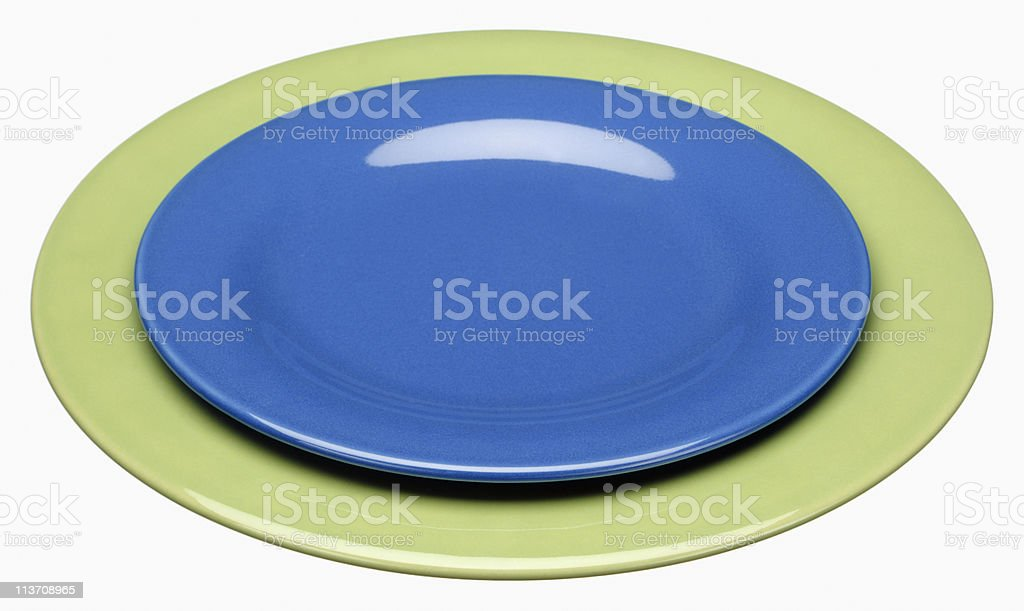 empty plates cut out on white stock photo