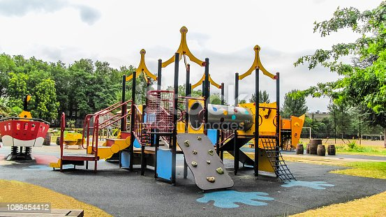 Outdoor Playground for Kids in Public Park with Lot of Playing Equipment