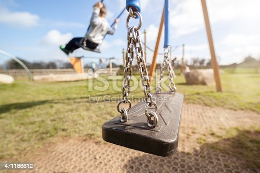 istock Empty playground swing 471186612