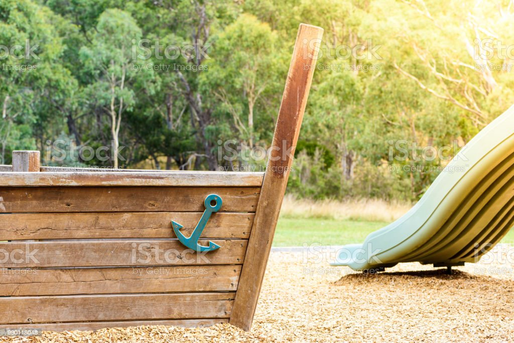 Empty Playground With Wooden Pirate Ship And Slide Stock Photo