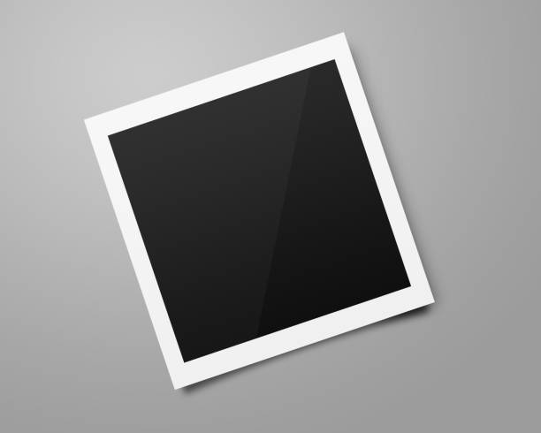 Empty polaroid photo frames mockups template on a gray background for putting your pictures. Paper sheet for printing images or recording picture of film cameras. stock photo