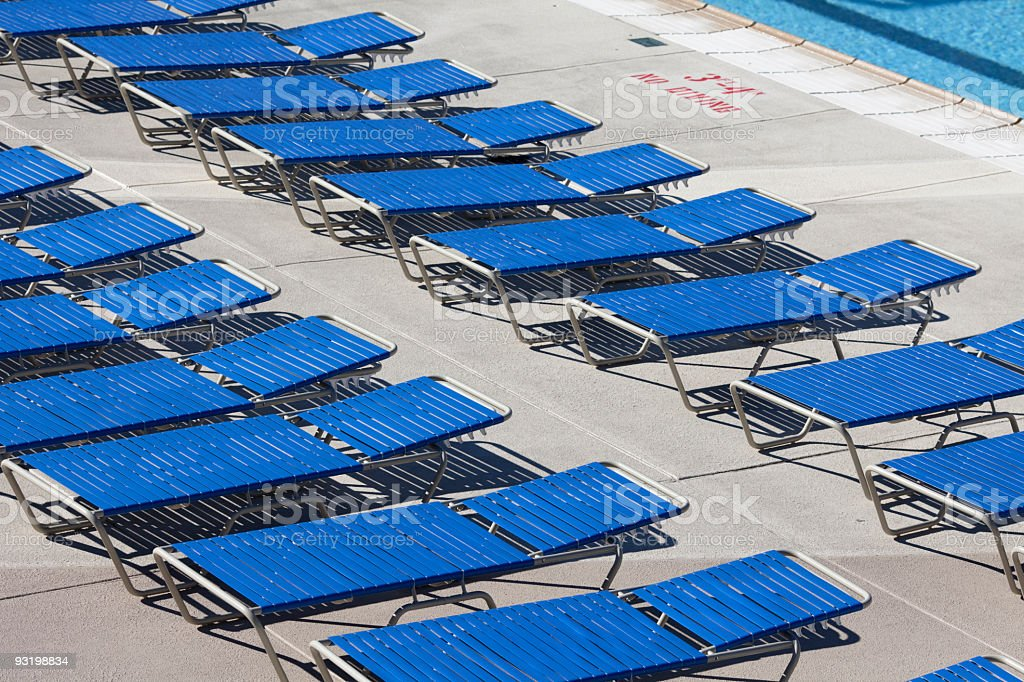 Empty Pool Deck With Chairs stock photo