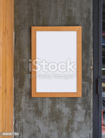 532332971 istock photo Empty poster in frame template on black wall 806367784
