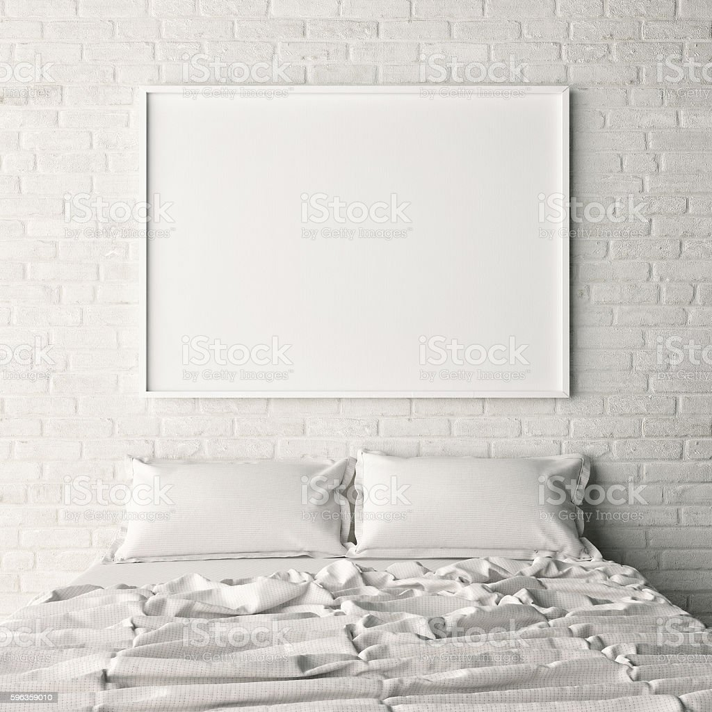 Empty poster on white brick bedroom wall stock photo