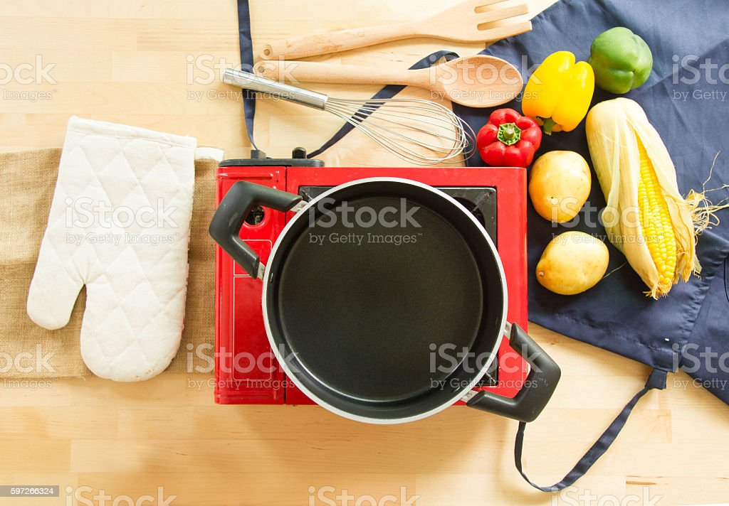 Empty Pot And Food Ingredients With Kitchen Utensils royalty-free stock photo