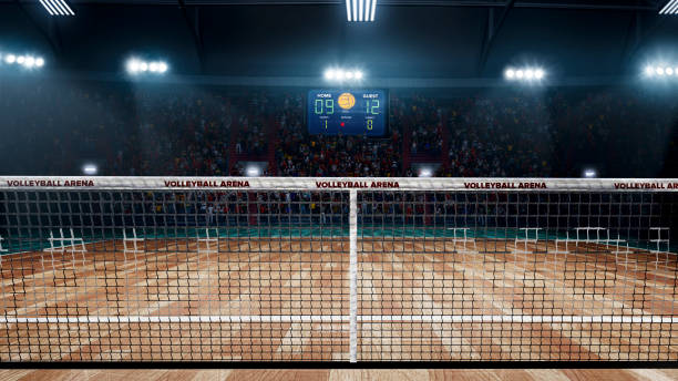 empty professional volleyball court in lights - volleyball stock photos and pictures