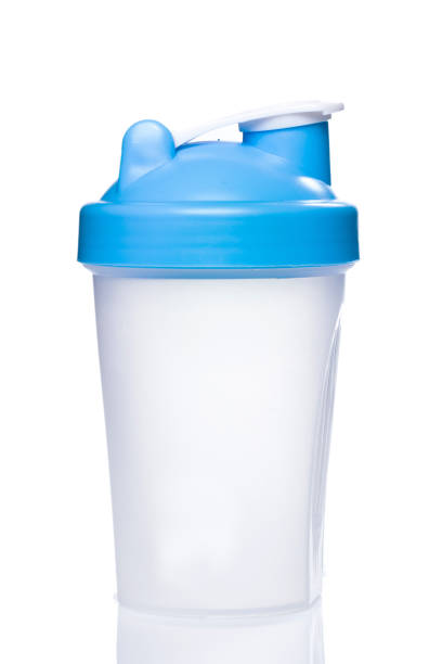 Empty protein shaker Empty protein shaker on white background cocktail shaker stock pictures, royalty-free photos & images