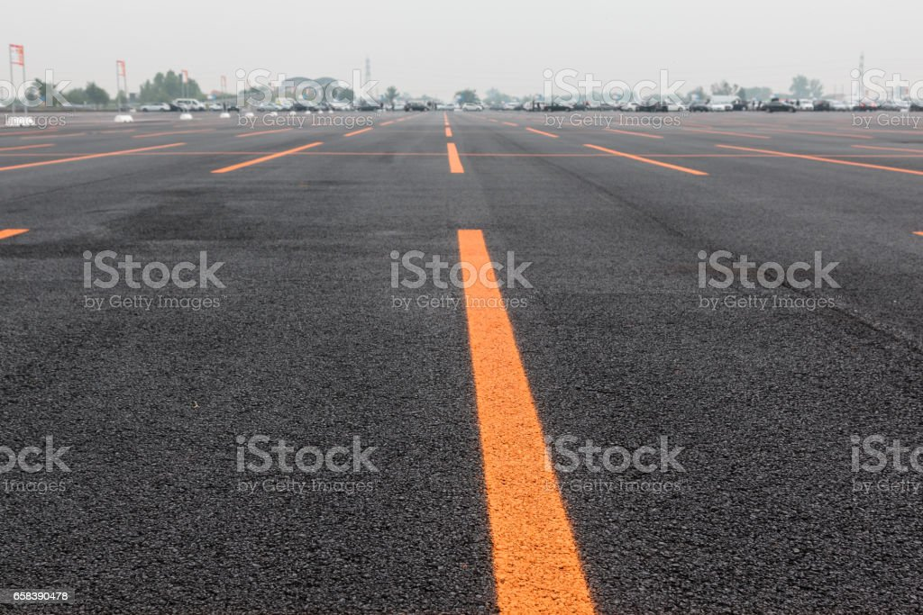 Empty Public Parking Lot with Orange Lines stock photo