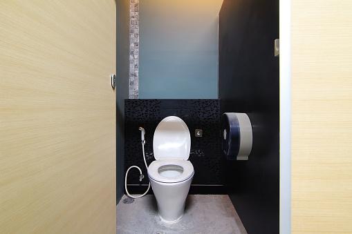 istock Empty public toilet and toilet bowl 964654668