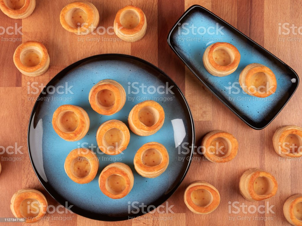 Empty puff pastry shells stock photo