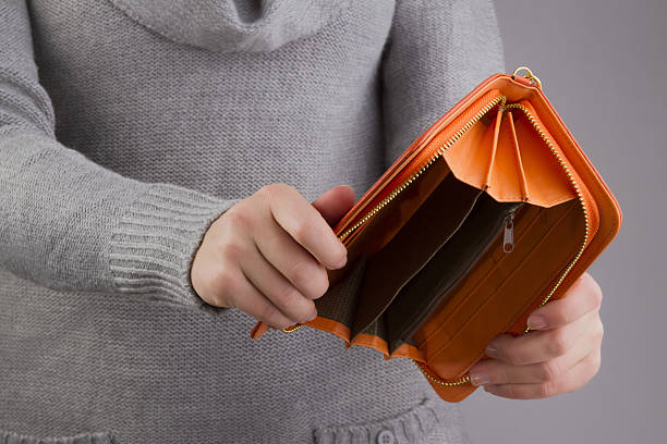 empty purse in women's hands empty purse in women's hands empty wallet stock pictures, royalty-free photos & images