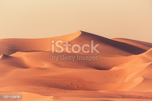Empty Quarter Desert Dunes. A sea of sand in the Rub' al Khali Desert under atmospheric sunset light. Empty Quarter Desert Dunes near the border of Saudi Arabia and the United Arab Emirates. Emirate of Abu Dhabi, United Arab Emirates, Middle East