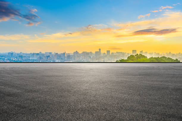 Empty race track and city skyline at sunrise in Hangzhou. stock photo
