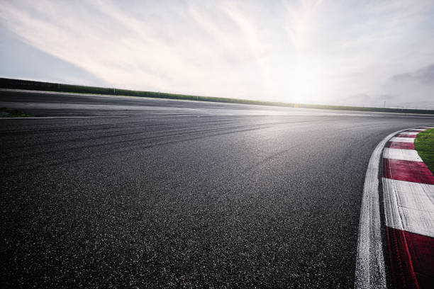 empty racing track with sunlight - motorsport stock photos and pictures