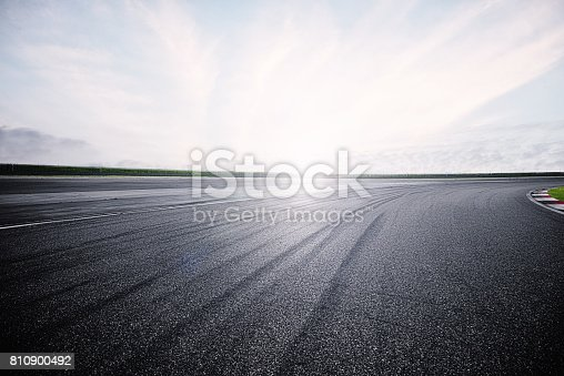 istock Empty Racing Track With Sunlight 810900492
