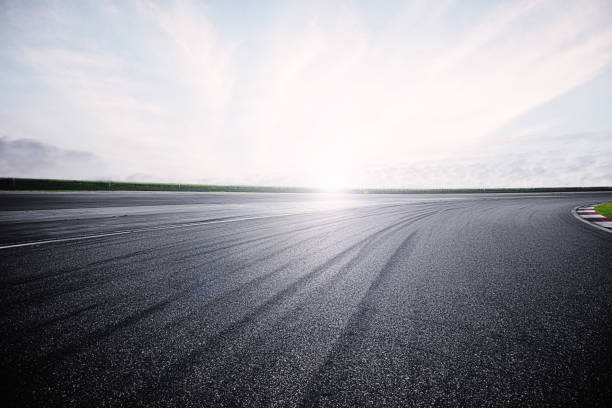 Empty Racing Track With Sunlight - foto stock