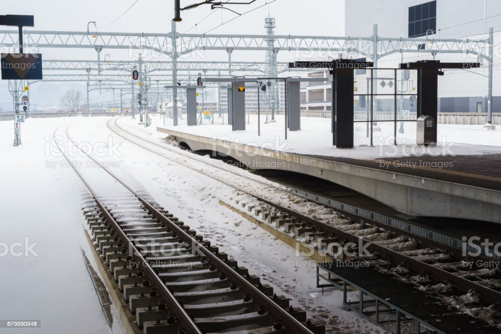 Empty railway and platform covered with snow royalty-free stock photo