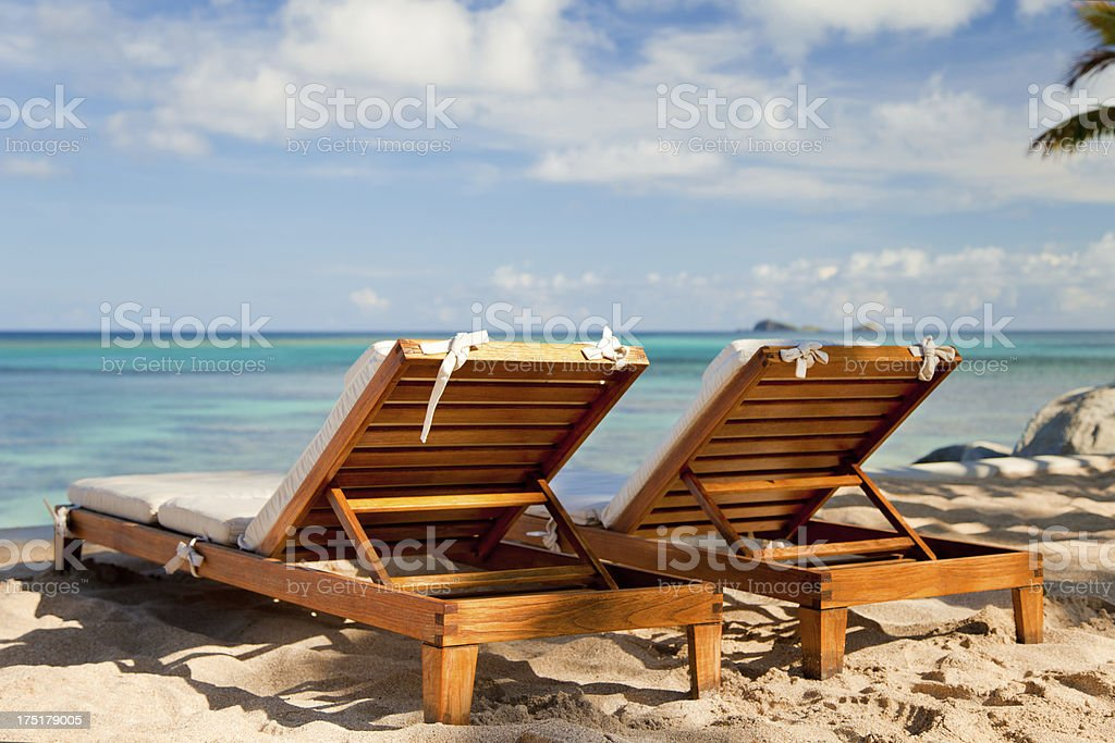 empty recliners on a tropical beach in the Virgin Islands royalty-free stock photo