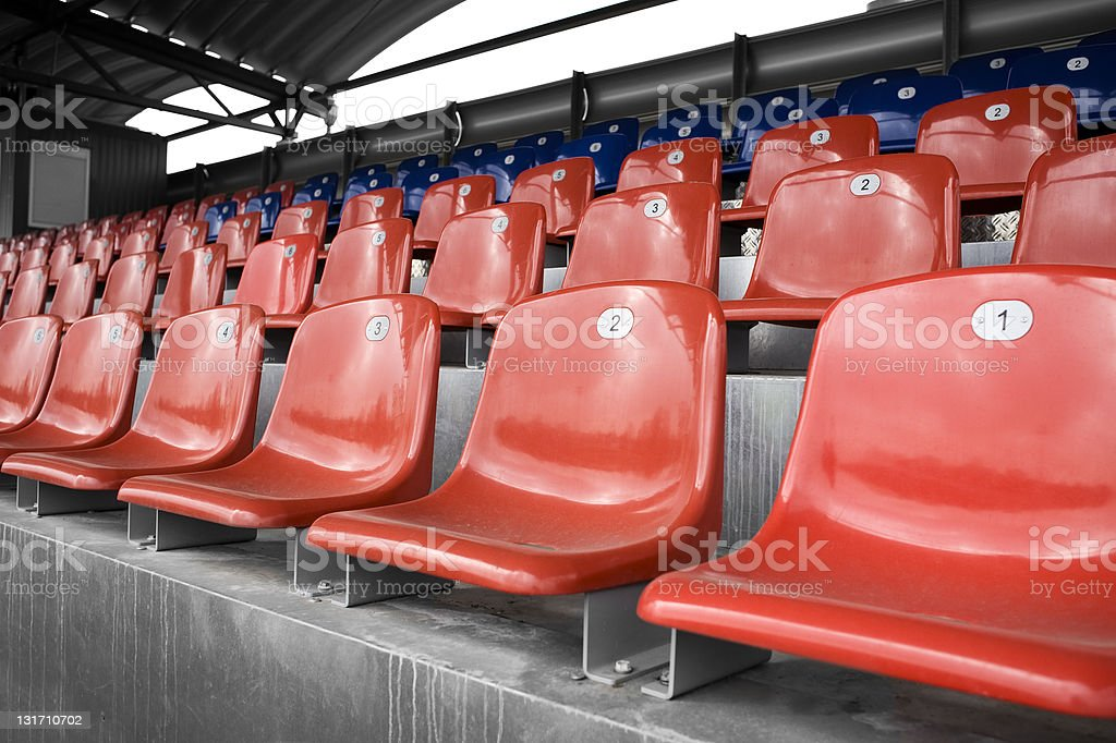 Empty red and blue stadium seats royalty-free stock photo