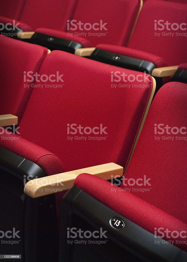 empty red bench number thirteen of the theater royalty-free stock photo
