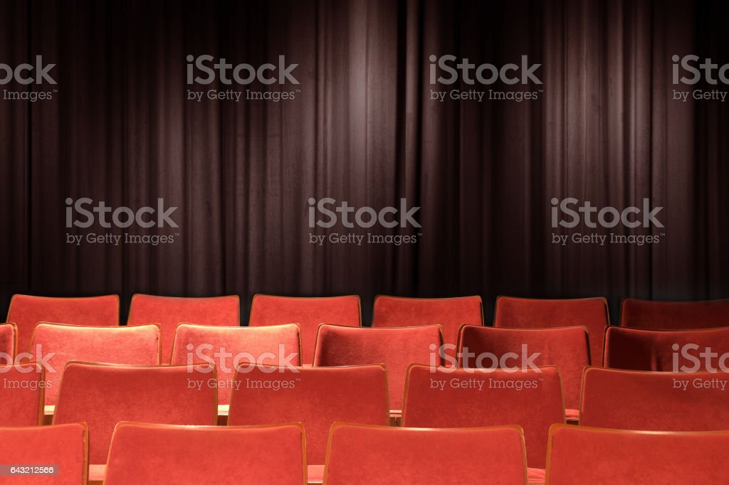empty red chairs at theatre with grunge background stock photo