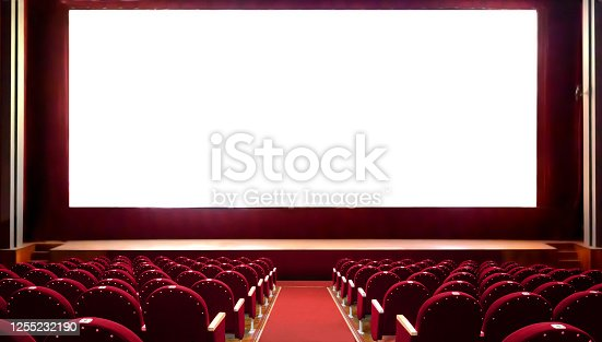 Empty red cinema seats with blank white screen for adding a picture. Empty cinema auditorium.