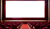 istock Empty red cinema seats with blank white screen for adding a picture 1255232190