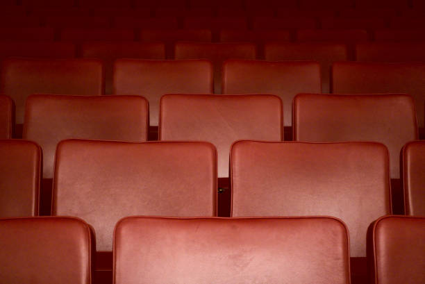Empty red seats of a theater after the curfew regarding corona virus stock photo