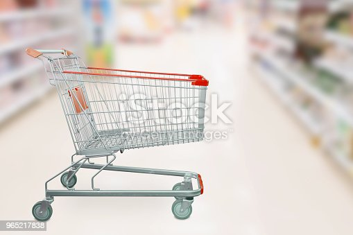 836871040 istock photo Empty red shopping cart with abstract blur supermarket discount store aisle and product shelves interior defocused background 965217838